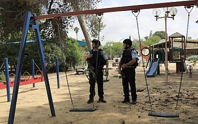 Israeli police officers guard a playground in a kibbutz near the Israel and Gaza border, Tuesday, May 29, 2018 (AP Photo/Tsafrir Abayov)