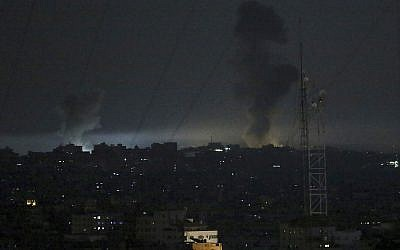 Illustrative: Smoke rises following Israeli strikes on Gaza City, early Wednesday, May 30, 2018. Palestinians in the Gaza Strip fired at least 50 rockets and mortars into southern Israel on Tuesday, the largest barrage since the 2014 war between Israel and Hamas. (AP Photo/Adel Hana)