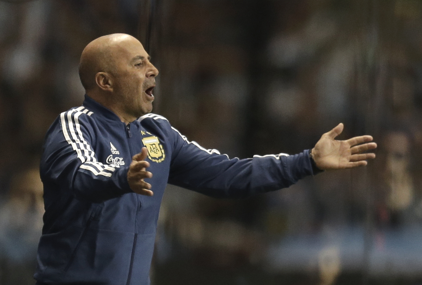 f1b119bb37 Argentina s coach Jorge Sampaoli shouts instructions to his players during  a friendly soccer match between Argentina
