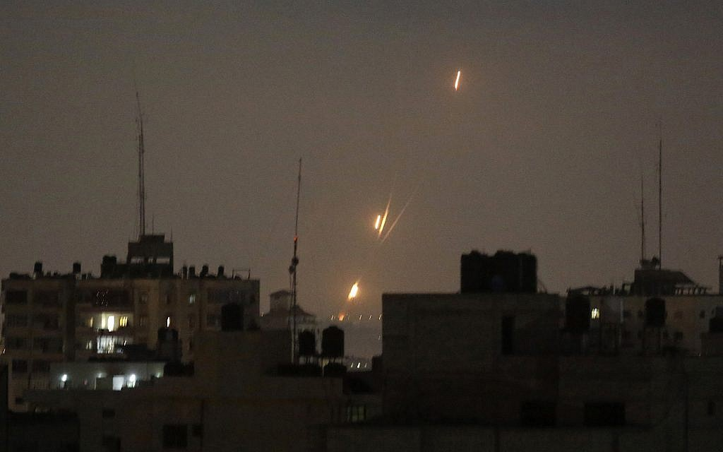Illustrative: Flames from rockets fired by Palestinians are seen over Gaza Strip heading toward Israel, in the early morning of May 30, 2018. (AP Photo/Hatem Moussa)