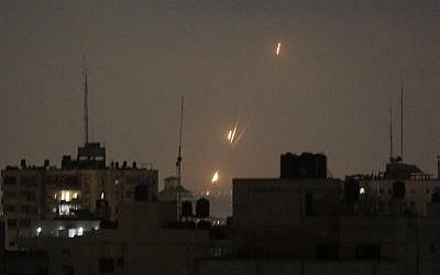 Flames from rockets fired by Palestinians are seen over Gaza Strip heading toward Israel in the early morning