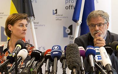 Belgian Federal Prosecutor Eric Van Der Sypt, right, and Federal Prosecutor Wenke Roggen address a media conference in Brussels, May 30, 2018. (AP Photo/Virginia Mayo)