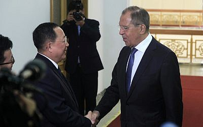 North Korean Foreign Minister Ri Yong Ho  (left) shakes hands with Russian Foreign Minister Sergei Lavrov at the Mansudae Assembly Hall, May 31, 2018, in Pyongyang, North Korea. (AP Photo/Jon Chol Jin)
