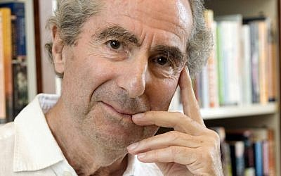 "In this Sept. 8, 2008 file photo, author Philip Roth poses for a photo in the offices of his publisher Houghton Mifflin, in New York. Annotated copies of his novels ""Portnoy's Complaint"" and ""American Pastoral"" brought in more than $130,000 Tuesday night Dec. 2, 2014 at a PEN American Center benefit auction hosted by Christie's. (AP Photo/Richard Drew, file)"