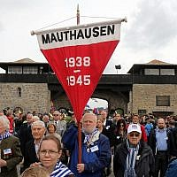Members of the international Mauthausen committee arrive for a ceremony to commemorate the 70th anniversary of the liberation of the Nazi concentration camp in Mauthausen, Austria, Sunday, May 10, 2015.  (AP Photo/Ronald Zak)