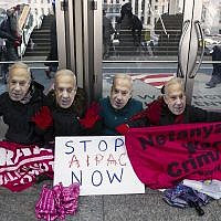 Pro-Palestine demonstrators wearing Israeli Prime Minister Benjamin Netanyahu masks, led by Code Pink, protest in front of doors of the Washington Convention Center, where the 2015 American Israel Public Affairs Committee (AIPAC) Policy Conference is being held, in Washington, Sunday, March 1, 2015. (AP/Cliff Owen)