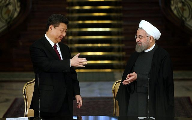 Chinese President Xi Jinping, left, and his Iranian counterpart Hassan Rouhani prepare to shake hands at the conclusion of their joint press conference at the Saadabad Palace in Tehran, Iran, January 23, 2016. (Ebrahim Noroozi/AP)
