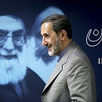 Iranian official Ali Akbar Velayati, a former foreign minister, walks past a portrait of supreme leader Ayatollah Ali Khamenei at the conclusion of his press conference in Tehran, Iran, June 3, 2013. (AP Photo/Ebrahim Noroozi)