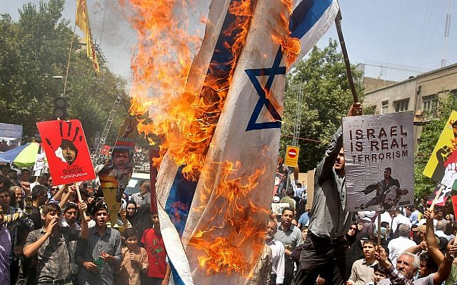 Illustrative: Iranians burn a representation of an Israeli flag as they chant slogans during an annual pro-Palestinian rally marking Al-Quds (Jerusalem) Day in Tehran, Iran, Friday, July 25, 2014. (AP Photo/Ebrahim Noroozi)