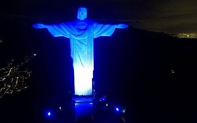The Christ the Redeemer statue in Brazil's Rio de Janeiro lit in blue and white to mark Israel's 70th anniversary on May 14, 2018. (Courtesy of Israel's honorary consulate in Rio via JTA)
