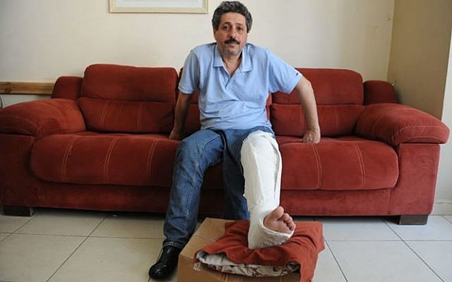Arab Israeli NGO worker Jafar Farah, who alleges a police officer broke his knee after he was arrested. (Screen capture: Twitter)