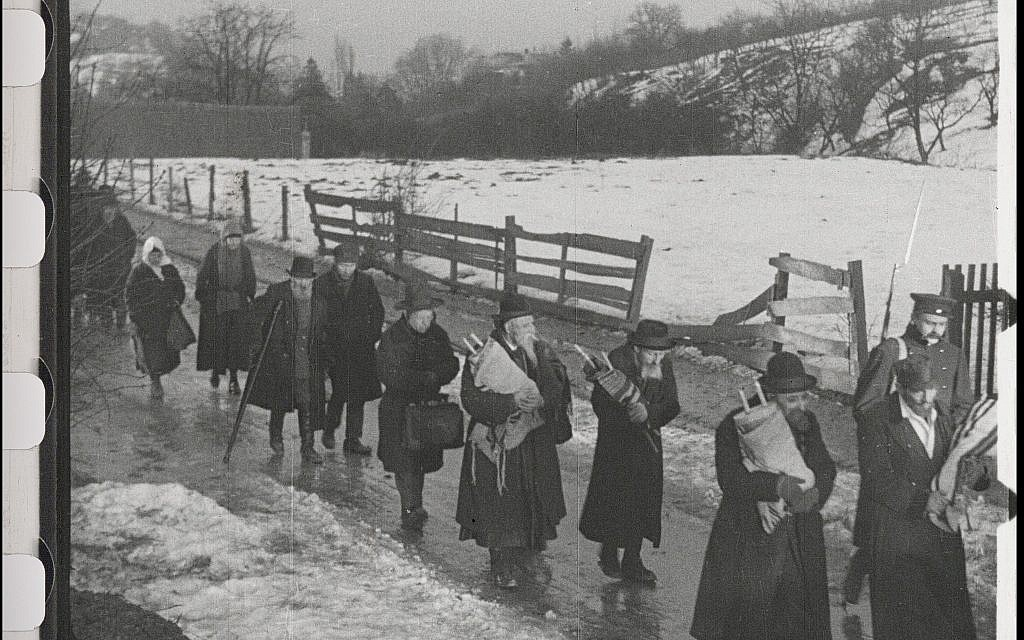 Jews carry Torah scrolls as they are banished from their town in the restored 'City Without Jews' (Courtesy of Film Archiv Austria)