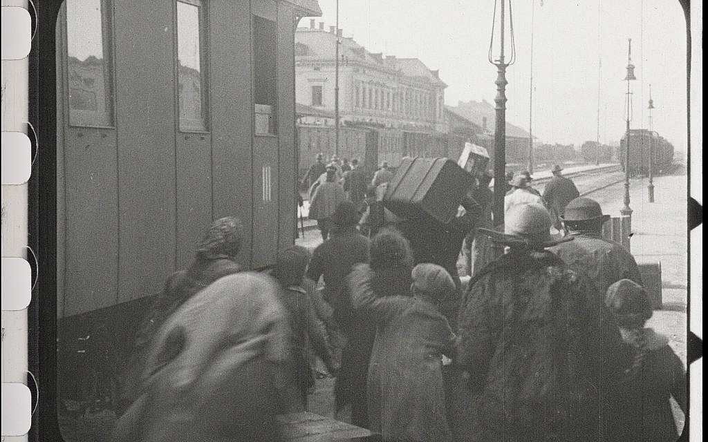 Jews arrive at train station for deportation in the restored 'City Without Jews' (Courtesy of Film Archiv Austria)