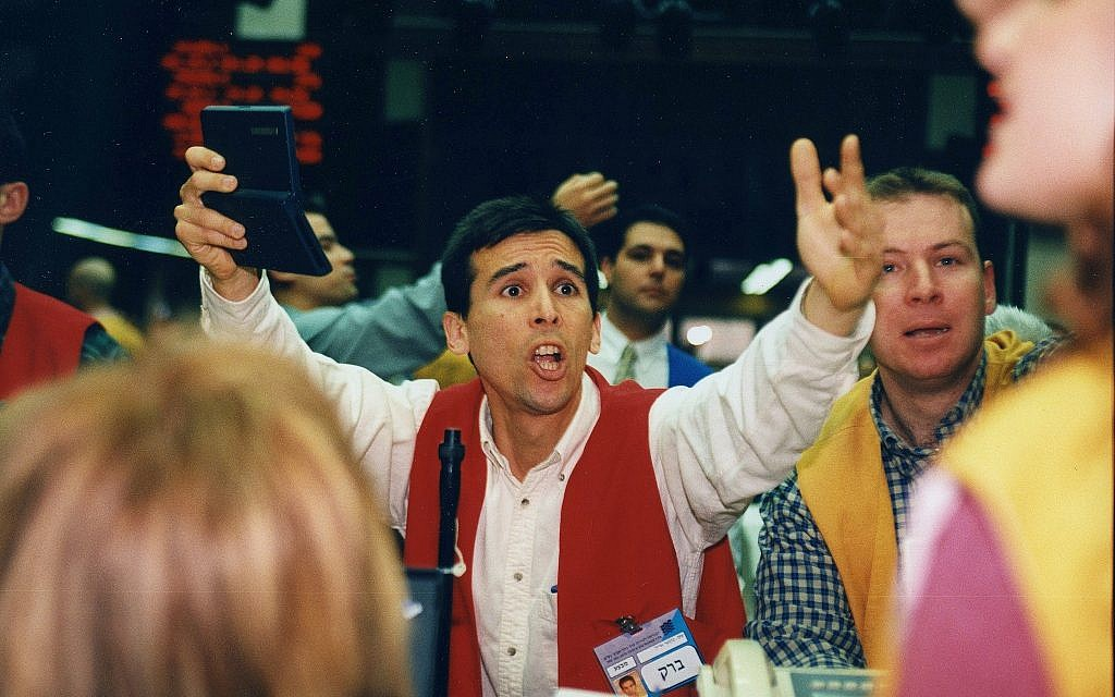 A broker at the Tel Aviv Stock exchange. (Moshe Shai/Flash90)
