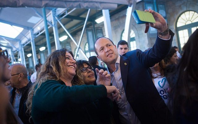 "Jerusalem Mayor Nir Barkat seen taking a selfie with Jerusalemites as he tours ""First Train Station"" in Jerusalem on March 24, 2015. (Miriam Alster/Flash90)"