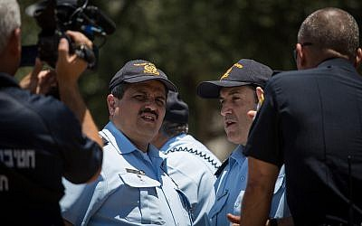File: Police Commissioner Roni Alsheich (2nd-L) and Jerusalem police chief Yoram Halevi (2nd-R) seen during a briefing at Damascus Gate in Jerusalem's Old City, on June 18, 2017. (Hadas Parush/Flash90)