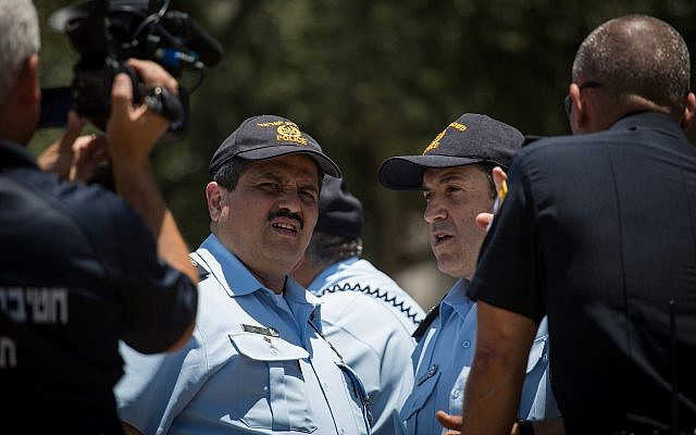 Police Commissioner Roni Alsheich (2nd-L) and Jerusalem police chief Yoram Halevi (2nd-R) seen during a briefing at Damascus Gate in Jerusalem's Old City, on June 18, 2017. (Hadas Parush/Flash90)