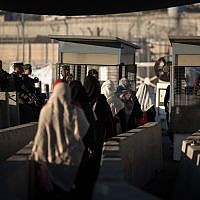 Palestinian women at the Qalandiya checkpoint outside of the West bank city of Ramallah, on June 23, 2017. (Hadas Parush/Flash90)