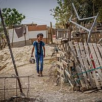 A young boy in the Bedouin village of Khan al-Ahmar in the West Bank. (Yaniv Nadav/Flash90)