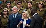 Prime Minister Benjamin Netanyahu and his wife Sara during a ceremony awarding outstanding soldiers as part of Israel's 70th Independence Day celebrations, at the President's residence in Jerusalem. April 19, 2018. (Yonatan Sindel/Flash90)