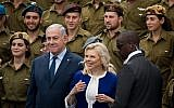 Prime Minister Benjamin Netanyahu and his wife Sara during a ceremony of awards for outstanding soldiers as part of Israel's 70th Independence Day celebrations, at the President's residence in Jerusalem, April 19, 2018. (Yonatan Sindel/Flash90)
