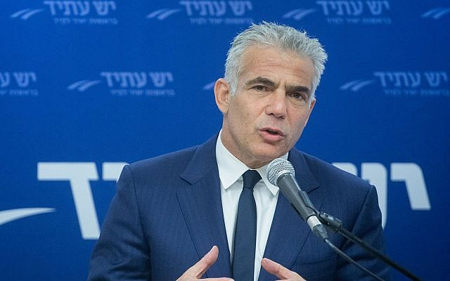 Yesh Atid head Yair Lapid leads a faction meeting in the Israeli parliament on April 30, 2018. (Miriam Alster/Flash90)