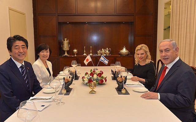 Prime Minister Benjamin Netanyahu (right) and his wife Sara Netanyahu host a dinner for Japanese Prime Minister Shinzo Abe and his wife Akie, at the Prime Minister's Residence in Jerusalem on May 2, 2018. (Kobi Gideon/GPO)