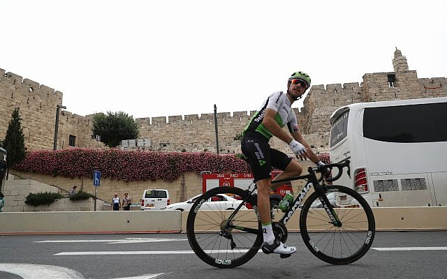 Cyclists train near the Tower of David in Jerusalem's Old City on May 4, 2018, ahead of the opening of the Giro d'Italia competition. (Yonatan Sindel/Flash90)