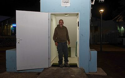 A man seen at the entrance to a bomb shelter that was open tonight in the Golan Heights, in northern Israel, May 8, 2018, (Basel Awidat/Flash90)