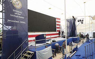Workers prepare the stage for the official opening ceremony of the US embassy in Jerusalem, May 13, 2018. (Yonatan Sindel/Flash90)