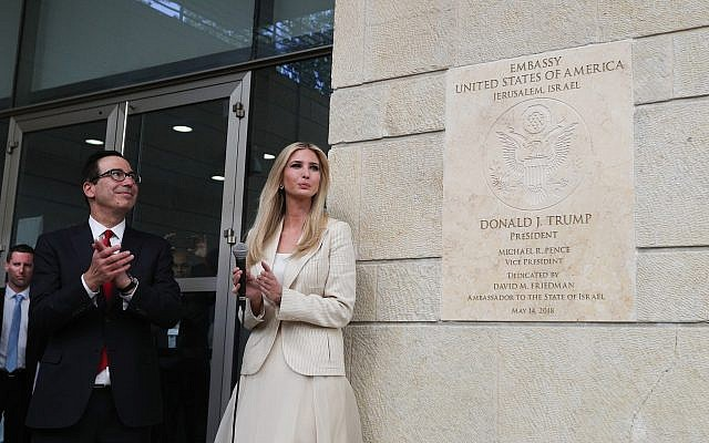 US Secretary of the Treasury Steven Munchin, left, and daughter of US President Donald Trump, Senior Adviser Ivanka Trump, unveil a dedication plaque during the official opening ceremony of the US embassy in Jerusalem on May 14, 2018. (Yonatan Sindel/Flash90)