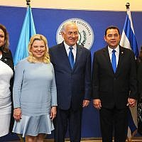 Prime Minister Benjamin Netanyahu his wife Sara, Guatemala President Jimmy Morales (2R) his wife Patricia (R) and Guatemalan Foreign Minister Sandra Jovel (L) pose for a picture at the official opening ceremony of the Guatemala embassy in Jerusalem on May 16, 2018. (Marc Israel Sellem/Pool)