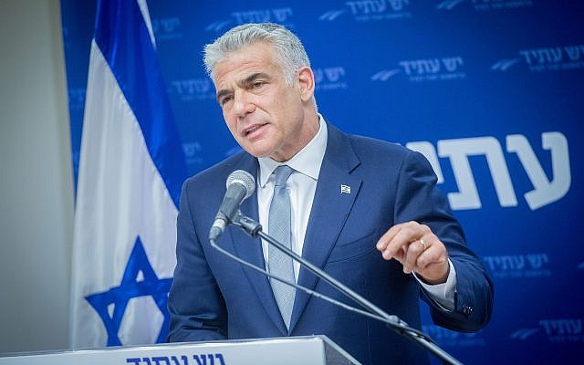 Yesh Atid leader Yair Lapid speaks at a faction meeting in the Knesset on May 21, 2018. (Miriam Alster/FLASH90)