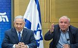 Prime Minister Benjamin Netanyahu, left, with coalition head and Likud MK David Amsalem at a Likud party faction meeting in the Knesset on May 21, 2018. (Miriam Alster/Flash90)