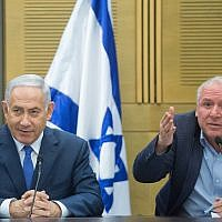 Prime Minister Benjamin Netanyahu, left, with coalition head Likud MK David Amsalem at a Likud party faction meeting in the Knesset on May 21, 2018. (Miriam Alster/Flash90)
