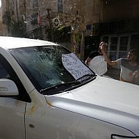 Palestinians attack cars of the United States Consulate in the West Bank city of Beit Jala, May 21, 2018. (Wisam Hashlamoun/Flash90)