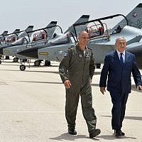 Prime Minister Benjamin Netanyahu walks with Commander of the Israel Air Force's Tel Nof Base Brigadier General Peleg Niego on May 23, 2018. (Kobi Gideon/GPO)