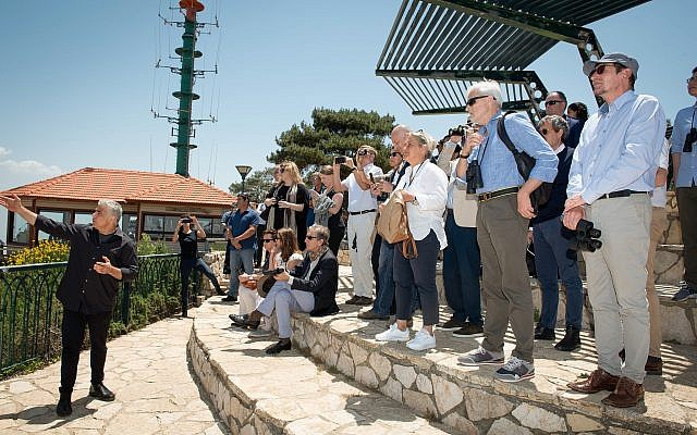 Yesh Atid party leader MK Yair Lapid, left, speaks during a tour with 40 ambassadors and diplomats from all over the world near a lookout point in Kibbutz Misgav-Am, northern Israel, May 24, 2018. (Basel Awidat/Flash90)