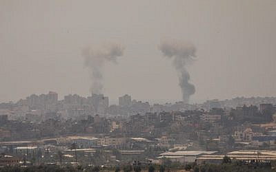 Smoke rises following Israeli strikes in the Gaza Strip, as seen from the Israeli side of the border on May 29, 2018 (Yonatan Sindel/Flash90)
