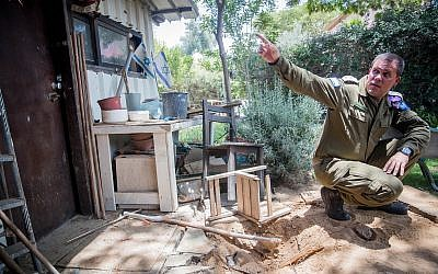 An Israeli officer officers inspects the scene where a mortar fire from the Gaza Strip hit a home at a kibbutz in southern Israel, Wednesday, May 30, 2018. (Yonatan Sindel/Flash90)