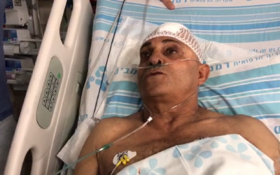 Bus driver Shimon Gabai, who was stabbed in the northern city of Afula, speaks from his hospital bed on May 3, 2018. (Screen capture: Hadashot news)