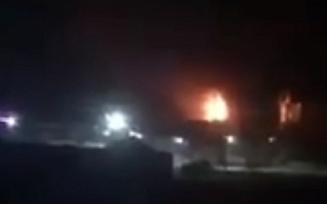 A still from a video claiming to show part of the Gaza seaport on fire. (screen capture: Twitter)