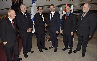 Paraguay' President Horacio Cartes (3rd-L) is greeted at Ben Gurion International Airport by Public Security Minister Gilad Erdan (3rd-R) after landing in Israel to attend the opening of the Paraguayan embassy in Jerusalem, on May 20, 2018. (Foreign Ministry)