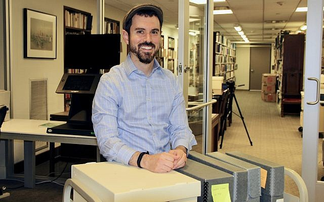 Dr. Joshua Furman is creating an archive of Houston's Jewish past in light of Hurricane Harvey. (Tracy Frydberg/Times of Israel)