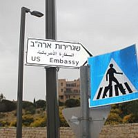 A newly hung sign points to the US embassy in Jerusalem, inaugurated on May 14, 2018. (Ben Sales/JTA)