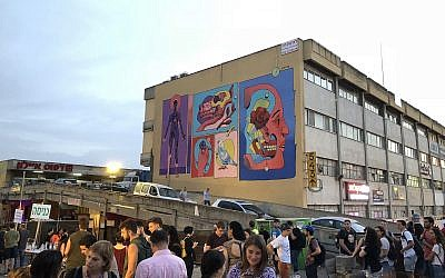 Massive murals amid the gritty urban landscape of Jerusalem's Talpiot industrial zone formed the background for Hiphopland, an opening event for Israel Festival 2018 (Courtesy Jessica Steinberg)