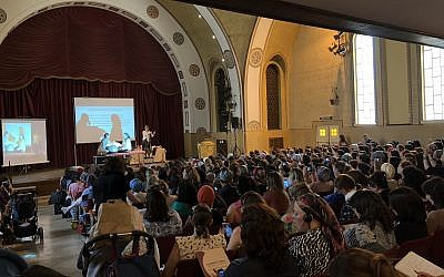 The Jerusalem YMCA auditorium full of midwives, doulas and childbirth educators at the two-day Childbirth Conference (Jessica Steinberg/Times of Israel)