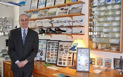 Marvin Goldman, in his New York City apartment, has created a mini museum of El Al artifacts. (Courtesy of Goldman/via JTA)