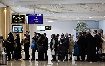 Illustrative photo of people waiting in a line at Mashhad International Airport in Iran. (CC BY 4.0, Nima Najafzadeh, Wikimedia Commons)