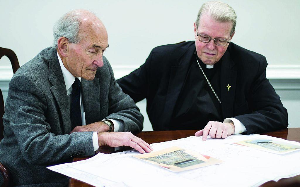 Dr. Michael Lozman, left, with Bishop Edward Scharfenberger go over plans for the memorial. (Courtesy)